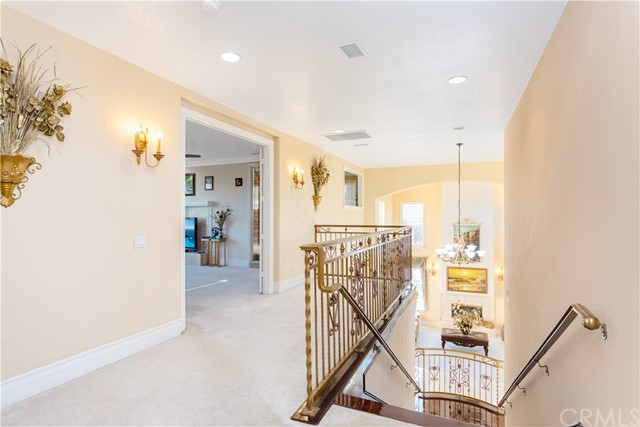 Top of the Beautiful Grand Staircase looking into Master Bedroom and Formal Living Room.