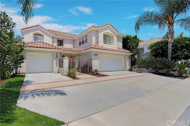 Beautiful gated community of MALAGA across from Tustin Ranch Golf Course.  Fantastic location in a cul-de-sac and does not back to a busy street or school.  Great curb appeal with private gated entry.  Stunning hardwood flooring and custom baseboards as you enter with amazing Cathedral Ceilings in the Formal Living and Dining Room, stunning Fireplace with Custom Mantle, Plantation Shutters throughout, Designer Ceiling Fans, Formal Dining Room with French Doors leading to Backyard, Gourmet Kitchen with Honey Glazed Cabinets with Oil Bronzed Handles and Gourmet Dark Island in the Center with Granite, Stainless Thermador Double Ovens, Bosch Dishwasher, Built-In Vent over Thermador 6 Burner & Griddle Cook Top, Wine Refrigerator, Built-In Refrigerator, Family Room Open to the Kitchen, Laundry Room with Granite Counters and Sink.   All bathrooms have been beautifully remodeled.  Spacious Master Suite with Tray Ceiling and Dual Walk-In Closets, Spa-Like Tub and Frameless Glass Shower Door, Dual Sinks, Plantation Shutters.  Unique plan with ALL upstairs bedrooms having their OWN Private Bath.  Such a Luxury!  Two Car Garage with Direct Access, additional Single Garage, great for storage or special car. Backyard Patio area with grass, great for kids and pets.  Low Mello Roos approx. $1310 per year, Low HOA $96 per month.  Conveniently located across from Golfing, Highly Rated Tustin Schools Schools:  Ladera, Pioneer, Beckman HS, Market Place and District Shopping, Freeways and Parks.