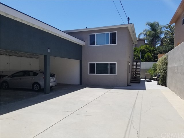 Beautiful downstairs 2 bed 1 bath unit. Newly remodeled. Ceiling fans.  laminate flooring.   Open kitchen.  Laundry in carport.  Within walking distance to downtown El Segundo shops & restaurants, blocks from the beach and LAX.