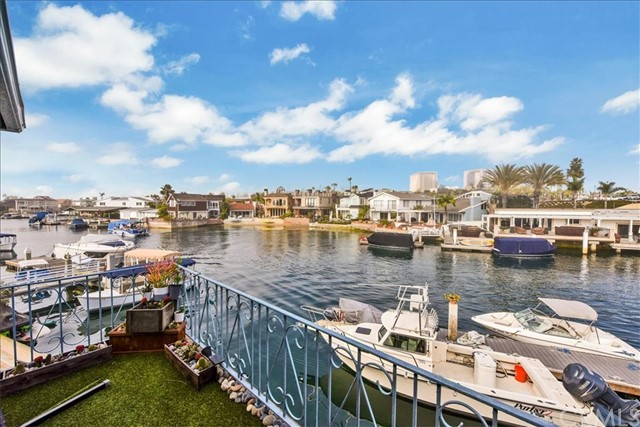 $400,000. Price Improvement on 3/1/2021...Act quickly to take advantage of this extraordinary waterfront opportunity in the heart of Newport Beach, where this ultra-rare four-plex offers a prime location across the harbor from the new upscale Lido Marina Village. Located at the end of a cul-de-sac, the rare double lot features a 50' boat slip and can be kept as an income-producing investment or completely redeveloped. Imagine creating an enviable waterfront paradise within moments of Lido Marina Village's boutiques, cafés and restaurants, miles of world-renowned beaches, recreation, top-rated schools, Orange County Airport and Hoag Hospital. Spanning approximately 7,850 square feet, the double lot is currently home to an income-producing four-plex. New decking and upgraded electrical was added in 2019. Three units offer 2 bedrooms and 1 bath, and one hosts 3 bedrooms and 2.5 baths. Opportunities as rare as this come but once in a lifetime...don't let it pass you by.