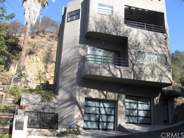 Ultra Chic Pied-A-Terre Nestled In Hollywood Hills/ NICHOLS CANYON With Beautiful Canyon/City Lights Views.  PROPERTY HAS ELEVATOR FROM GARAGE TO TOP FLOOR.  Impeccably Furnished And Decorated.  This Spacious One Bedroom/1.5 Bath, Two-Story FURNISHED HOME Offers All The Amenities And Luxuries One Could Ask.  Gorgeous Living Area W/Beautiful Hardwood Flooring Thru-out, Gourmet Kitchen W/Custom Cabinetry and Stainless Steel Appliances, Breakfast Nook, Formal Dining Area, Spacious Master Suite w/ Office Area/Nook.  Ample Closet Space Thru-out, Master Bathroom Offers Custom Tile/Glass/Separate Shower Tub.   Two Large Balconies To Enjoy The City Lights And Canyon Views.  Two-Car-Garage And Bonus Area Provide Extra Space For Storage And Laundry Facilities. Very Private And Secure W/Alarm System. Just A Few Minutes Away From Sunset Blvd. OR Studio City . . . No Need To Preview.  TURNKEY!