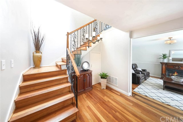 Welcoming entry with attractive wood and iron stair railing