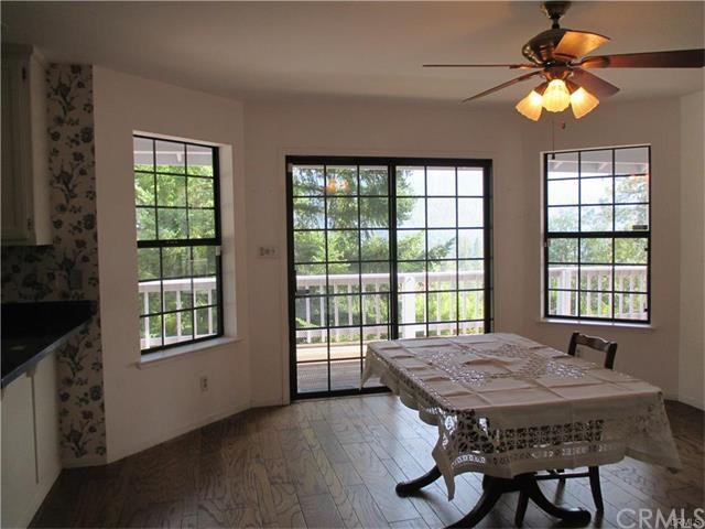 Dining room has wood flooring and a view.