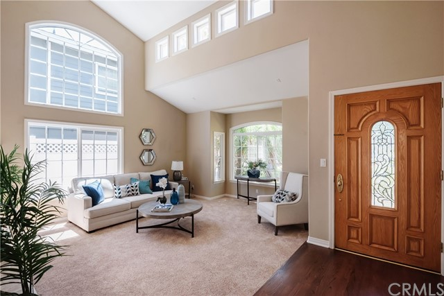 Interesting architectural details and extensive use of natural light, hardwood floor entry