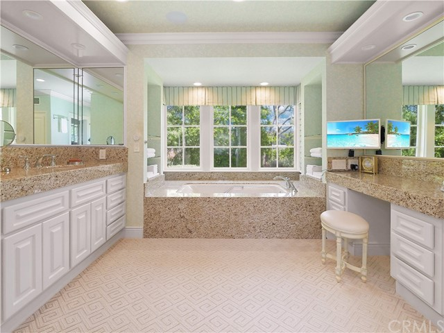 Master Bathroom - with double vanity, his & hers walk-in closets...