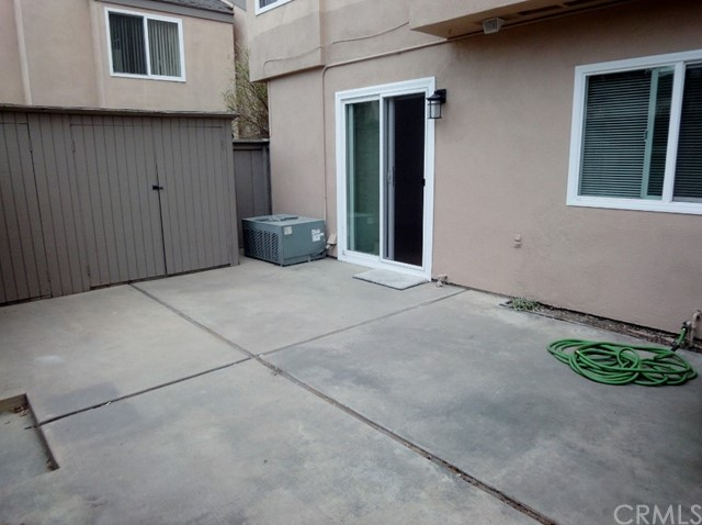Large private patio with lots of storage cabinets. Hot water out here too!
