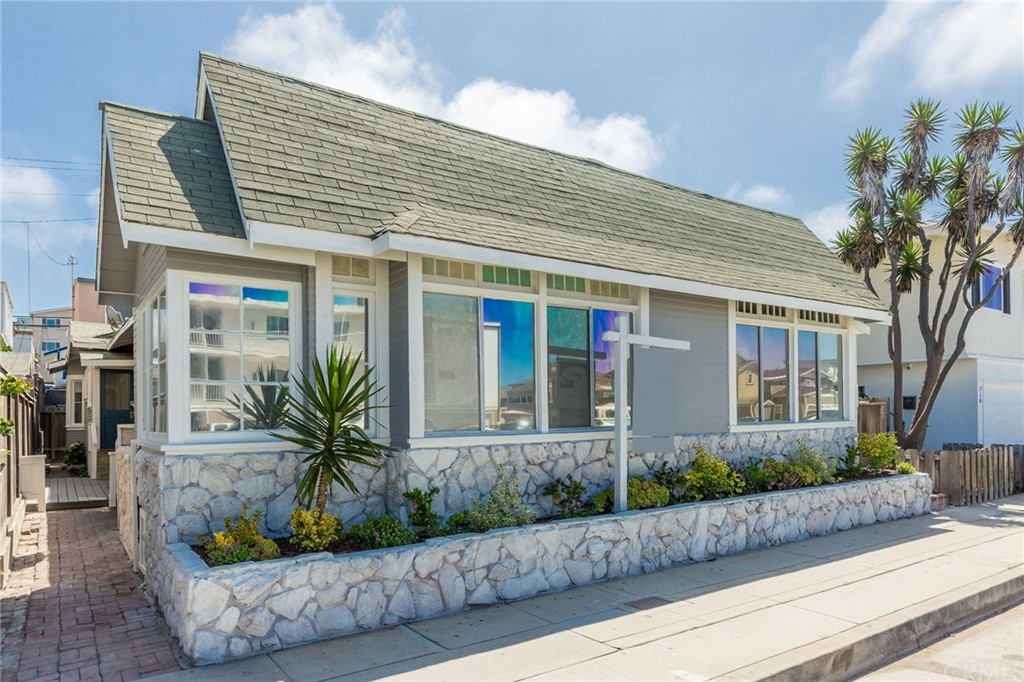 Your Flex-Use Vintage California Beach Cottage awaits!  Freshly painted inside and out, with new flooring, ceiling fans, lighting and landscaping, an inviting, beachy character shines through.  Classic charm like this simply can't be replicated in newer buildings, and there's a further value-add opportunity by upgrading the kitchens and bathrooms. As a duplex, this property provides many flexible and versatile use options.  1) Hold it as a legacy investment property to build generational wealth as the current owners have.  2) Live in one of the units and rent out the other for income - the rent will offset about $900k of your mortgage, making it a compelling effective net purchase of $1.6m.  3) Use it as a fun vacation home or vacation rental where the side-by-side units provide co-living for extended family/kids in their own private spaces.  4)  Set your children up to live in a family-owned property while they attend college or start their professional life, then retain for investment or build your dream home.  5) Develop a beautiful new 4,400+ sf 3 story home with an ADU that would be worth approx. $5.5m in today's market.  Positioned on a coveted west-facing 40' extra-wide lot, the building is currently configured as a 2 bedroom, 1 bath on the south side.  On the north side there's a 1 bedroom, 1 bath in the front plus a studio and bath in the back. Each unit has some outdoor space to enjoy the glorious weather and sunshine.  It's all about life by the beach here.  This is a fun and active, car-optional location, ideal for beachgoers who love being in the mix and close to Pier Plaza's restaurants and shops, The Strand, and summer beach concerts.  Hermosa's pristine wide sandy beach is just 8 doors away and is the favored training ground of pro beach volleyball players including Olympic Gold Medalists Alix Klineman and April Ross among many others.  It's all about life by the beach here.
