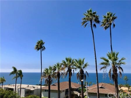 """Stunning Ocean View Condo. This absolutely stunning front row unit in the prestigious """"Aliso Laguna"""" complex with no unit above or below. This breathtaking completely FURNISHED home boasts an unbeatable location within moments of several gorgeous beaches such as """"Aliso Creek,"""" """"Victoria Beach,"""" and the PUBLIC PARK of the MONTAGE RESORT. The spacious open living room floor plan features a designer kitchen with custom cabinets, quartz countertops, and a Carrara marble backsplash. Find serenity throughout the many finishes including a stone fireplace with custom mantel, large plank wood floors, and a custom wrought iron staircase. The Master bedroom features cathedral ceilings, a private view deck, large walk-in closet, an additional mirrored closet, and breath taking ocean views. The master bath has dual vanities with marble counter tops, glass shower and large soaking tub. The secondary bedroom also has stunning ocean views, and a large closet. Excellent ocean views from all levels of the property, decks on both levels, as well as a slider out to the patio in front. A gated community with subterranean parking space with storage AND a ROOF TOP POOL with amazing views of the coast. ENJOY STEPS to the nearby shopping center as well as the renowned Montage Resort & Spa, """"THE RANCH"""" GOLF COURSE, beaches, shops, restaurants and grocery store."""
