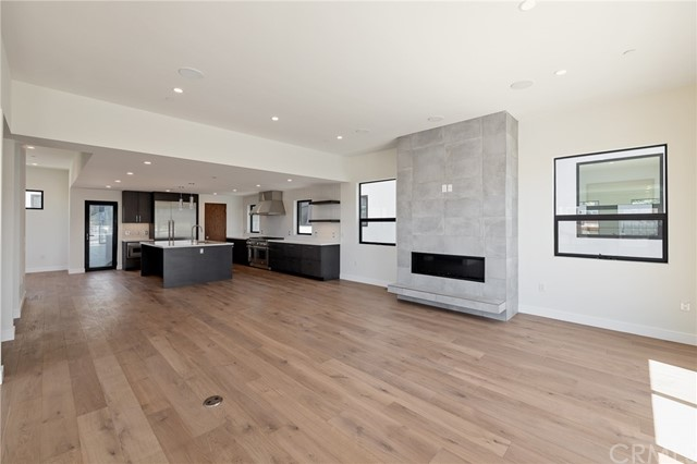 Modern floor to ceiling fireplace anchors the versatile living space