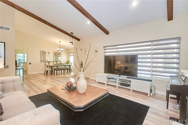 This SINGLE STORY gem is a must see! Located in the prestigious community of Country Hill in Brea, this beautifully remodeled home is on a cul-de-sac. Adjacent to a greenbelt with a walking path to Country Hills Elementary School. This lovely and well-maintained home is light & bright with upgrades throughout. From the moment you walk into the living room, you will see high ceilings & feel the wonderful energy and positive flow. Newly installed energy saving double pane windows throughout the home. Large kitchen with a center island opens to the family room & has been upgraded with beautiful quartz counters, quartz backsplash, stainless steel appliances, and beamed ceiling with recessed lights. The charming family room has direct access to the enclosed sunroom, which is not included in total living square footage. Beautiful wood floors flow throughout the home and entry contributes to the open concept feel. Spacious master bedroom and master bath with dual sinks, and upgraded shower room. Other two bedrooms have mirrored closets and recessed lights. Fourth bedroom is currently used as a den but can easily be converted into a warm, functional bedroom. 2 car garage with direct access. Great central location, close to top-rated schools in the award winning Brea Olinda School District, parks, shopping, dining, and 57 freeway. Enjoy community amenities including two swimming pools, two spas, sports courts, tot lots and walking paths.