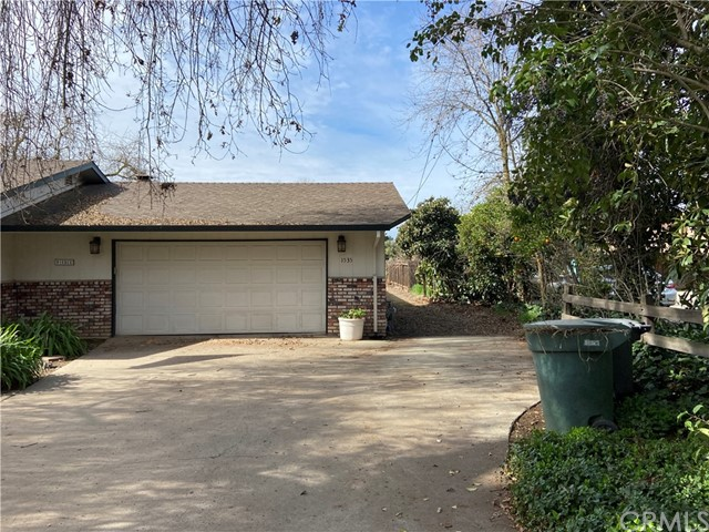 Drive way to back yard, right side of garage.