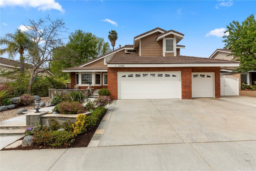 Price Improvement!! All that Lake Forest has to offer! 4 bed 3 bath,w 1 bed&bath down.Appx 2246 sqft on extremely private appx 8775 sqft lot.Amazing curb appeal, gorgeous entry w patio, extensive natural stone hardscape & lush landscape.Extended 4 car drive  w possible gated storage access.Enter thru custom front door to formal living room with volume ceiling &laminate flooring that extends throughout the house. Recently remodeled, eat in kitchen w Corian counters,grey cabinets,glass tile backsplash & stainless LG appliances overlooks backyard,pool &entertainment area.Large family rm w fireplace,ceiling fan &TV.Remodeled down bath w custom vanity,quartz counter & stainless fixtures. Custom shower w glass enclosure& Hans Grohe fixtures &rain shower.Huge master suite w volume ceiling&modern ceiling fan.Master bath w dual vanity,oversized jacuzzi tub, custom shower &huge walk-in closet w organizers.Large secondary bedrooms finish the spacious 2nd floor.One bedroom used as office w built-in desks&cabinets.Backyard is entertainer's dream! Huge extremely private pool w Baja step & spa. Built in stainless BBQ &sink, eat at bar & cozy fire pit. Tropical landscaping w beautiful Coral, Lemon, Lime &Tangelo trees. Large gated side yard w 2 storage sheds.Inside laundry. Oversized 3 car garage with sink & builtin storage.Tesla solar, newer pool equip, HVAC, water heater &roof.Energy efficient tinted vinyl windows throughout.Located near shopping, entertainment and freeways!