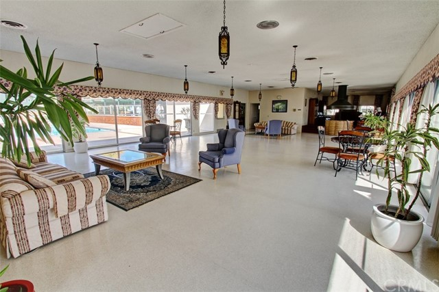 Clubhouse features a Beautiful Sitting area overlooking the Pool Area.  Also an adjacent Room for Watching TV, an additional room for Puzzles and Reading.