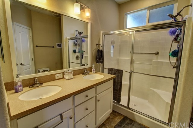 Master Bathroom with Dual Sinks and Walk In Closet