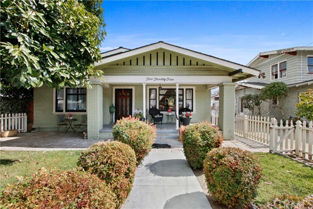 """Your new home awaits at this classic Craftsman style house in the heart of Historic Old Towne Orange! Shaded by the well established avocado tree, the front poach boasts a welcoming curb appeal true to the preserved design. Walk just one block to be dining and shopping at the Orange circle. As you arrive, take note of the original hardwood floors throughout the living and dining area that lead you to the built in buffet with showcase cabinets. The kitchen has been updated with granite countertops, hard laminate flooring and ceiling fan light fixtures.  Splashes of classic style still appear in the kitchen such as the functional antique range/ oven. As you step out the French doors from the kitchen, a raised deck leads you out to the well maintained back yard that features an historic orange tree that still produces fruit. There is a detached """"carriage house"""" style garage that adds to the antique charm of the property. The back yard is also home to a detached office that is fully insulated and has electricity, laminate flooring and an AC unit. But don't stop exploring there, as the 3rd bedroom was converted into a 1bd 1bth apartment with a new separate entrance, perfect for either a rental opportunity or a family member to stay. This home has become an iconic staple in town known for its stunning annual lights and decoration display at Christmas time. Winner of the Holiday Home Decoration Contest """"Best use of Lights"""" as well as the prestigious """"Most Beautiful"""" awards. Between it's location, charm, and various functionality, this home has it all!"""