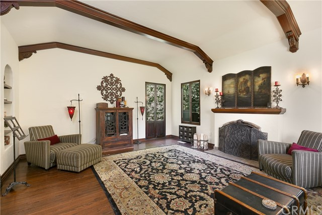 Living Room with Hardwood Floors, and French Doors leading to the Side Yard
