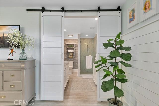 Barn doors lead to the master bathroom.