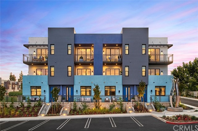 BRAND NEW CONSTRUCTION. This Designer Home features 2,200 sf of living space with custom upgrades valued at 125K: 2-CAR ATTACHED SIDE-BY-SIDE GARAGE, gourmet kitchen and open floor plan. 3 bedrooms plus a 3.5 baths. A bedroom on EACH floor for privacy for each family member. Contemporary kitchen includes a KITCHEN ISLAND with quartz countertop. Upgraded laminate wood flooring. This home will come with a new home warranty administered through the builder.  Beautiful community, parks, water park/tot lot and walking trails. Close to freeway access and shopping nearby. Excellent school district. COME TO THE SALES OFFICE TO VISIT.  This is the final home. Don't miss out this opportunity!