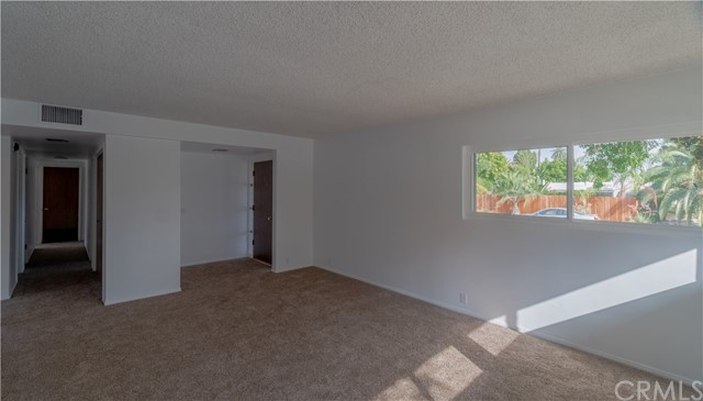 Entry door and living room. Looking down the hallway to bedrooms.