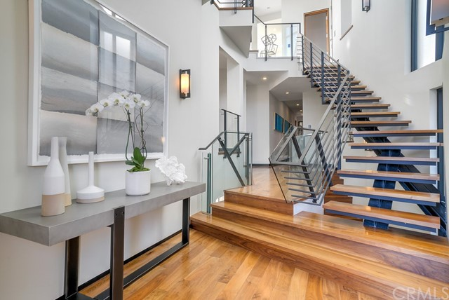 Dramatic entry with floating staircase