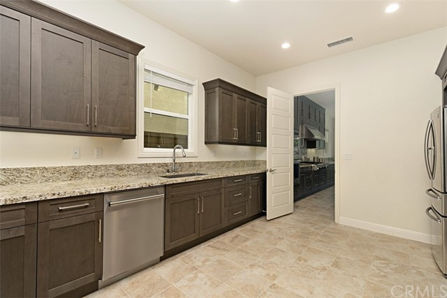 Second kitchen upgraded larger STAINLESS STEEL sink and additional dishwasher.