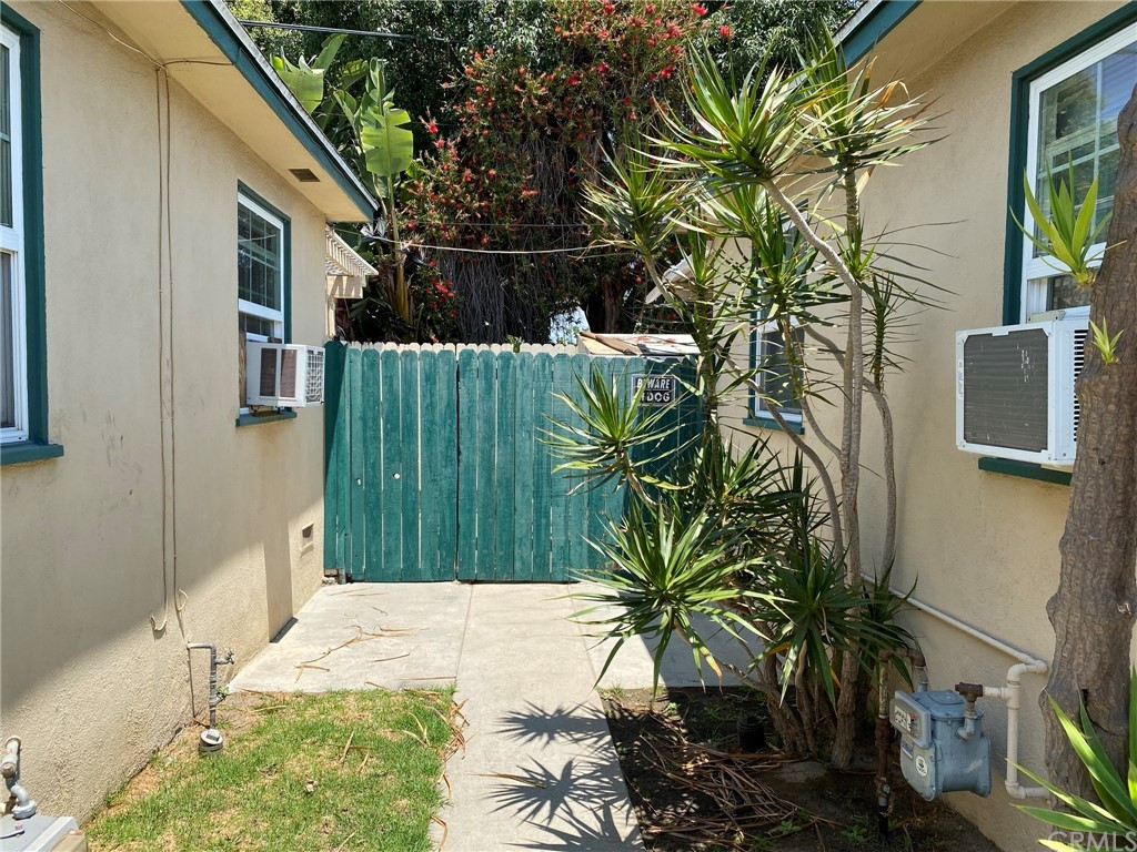 Walkway between back 2 units. This listing includes the unit on the left.