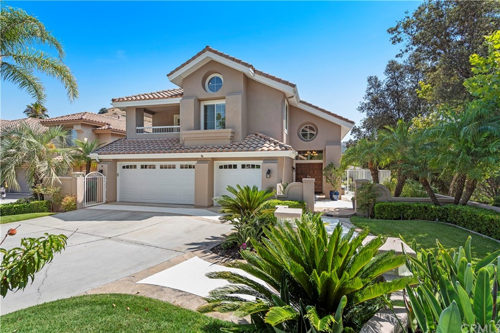 There MUST be a better word than ....BEAUTIFUL!? It is pristine, warm, inviting, gorgeously upgraded, thoughtfully designed & this is a picture perfect 'HOME', in every sense of the word for some very LUCKY & discerning buyer! A place where you can celebrate every day & those you love.  Tucked away in the Estates at Hidden Ridge where it is QUIET & secluded but NOT TOO MUCH SO! You are still so close to everything & going north is a breeze.  SO: there are 5 bedrooms with one down. It is a REAL bedroom with direct access to the beautifully remodeled bathroom. Upstairs,4 more bedrooms that are well sized, PLUS a bonus room. The master & retreat with a 2nd see-through fireplace is serene, & the remodeled bathroom is beautiful! A tub, separate shower, large walk-in closet, built-in bookcase & lovely view.  There is a deck off the front bedroom & the bonus room & GUESS WHAT?  There is YET ANOTHER bed in the bonus room - a Murphy Bed! You can pretty much invite the universe for a party, sleep over or Holiday evenings! Downstairs there is an exquisite living room with built-in display book case, a beautiful staircase, DREAM kitchen where you will never want for storage or counter space!  Gorgeous white toned granite, exquisite rich wood floors, lighting, appliances & just name it - It is ALL here.  This is  'GREAT ROOM' with dining area & beautiful access to this phenomenal lot & view.  Did I remember to tell you that there is the PICURE PERFECT office also? You will LOVE WORKING from home, again with more fabulous built-ins incl. glass French doors?  The crowning glory to ALL THIS elegance is the approximate 26,000 sq. ft. lot.  There is a mammoth driveway & front yard including a peach tree and so many gorgeous trees planted with the express purpose of giving you SHADE, CALM, SECLUSION, & BEAUTY... they are the heroes of nature!  Being near trees, lessens our blood pressure, reduces depression & anxiety & you can sit here listening to the sound of the wind whispering thr