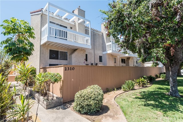Great opportunity to enjoy beach living! This front end unit is move in ready and offers 3 beds and 2 1/2 baths with 3 outdoor areas, an enclosed patio off the freshly painted kitchen with new stove/oven gas range , hood and dishwasher.  An enclosed patio off the spacious living room with vaulted ceilings and an inviting fireplace.  A nice sized master suite with a balcony also with vaulted ceilings. This unit is light bright and breezy and  has gorgeous  solid oak floors throughout. All the bedrooms are upstairs and has a great floor plan.  It also features an attached two car garage with washer and dryer hook ups, updated garage door and motor, updated windows and a new water heater.  Conveniently located to beaches, shopping, freeways and award winning schools. LOW HOA and well maintained SMALL complex . This is the one you don't want to miss!
