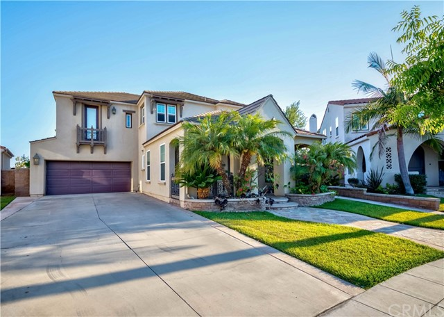 """RARE OPPORTUNITY! STUNNING """"Talmadge"""" South facing home located in the prestigious Amerige Heights Community. This elegant 4 bedroom + large loft, 3.5 bathroom home sits on a premium corner lot and boasts an extra long driveway that leads to the built-in 2 car garage. Enjoy the functional floor plan layout of a full bedroom and bathroom downstairs offering versatility and privacy for guest quarters or home office. Lounge with the family in the large living room and spoil yourself with the open gourmet kitchen with granite countertops, spacious center island & stainless steel appliances,  master suite-2 walk-in closets, oversized bathroom  with dual vanities, separate shower and garden tub. Professional landscaping includes a beautiful front porch and backyard where you can enjoy BBQ and entertain with friends & family. Walking distance to award-winning Robert Fisler Elementary/Jr High and minutes away Sunny Hills High School & Amerige Heights Shopping Center. HOA offers Internet, sidewalk grass gardening, community parks, tennis courts, clubhouse, playgrounds.  This home is one in a million!"""