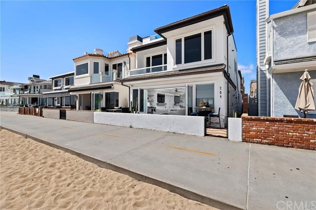 This unique quintessential beachside property is situated on a prime lot, perfectly positioned between Newport Pier and the Balboa Pier. Each condo features breathtaking views of the surf and sand, with stunning sunsets in the evening, and a layout optimized for seamless indoor-outdoor living. The upper-level condo features an open layout with 3 bedrooms, 2 bathrooms, and a rooftop deck for entertaining. The bottom-level condo features 2 bedrooms, 1 bathroom, and opens to a private patio looking out over the boardwalk and beach. Just steps from the sand, this Balboa Peninsula property offers a serene setting with white water views of the sparkling Pacific Ocean as the backdrop of your daily life. Exquisitely designed, each single-level living space offers high-end finishes such as limestone flooring, top-of-the-line appliances, and custom cabinetry – all blending together to embody elegant coastal living. Comfortably situated in one of the most desirable areas of Southern California, this remarkable property is located just minutes from the Ferry, Fun Zone, the Wedge, and world-class shopping and dining. With the rarity of two true oceanfront condos, this property offers a once-in-a-lifetime opportunity to live in one home while renting the other or to have a separate guest home for friends and family.