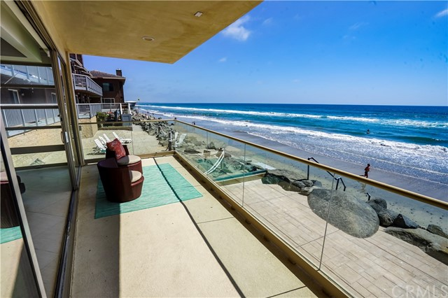 """OCEANFRONT DREAM CONDO. Custom built with walls of glass out to crashing waves from beachfront balcony. Only 2 condos. This is well located in the """"Strand"""" section of Oceanside with NO public walkway. 3 Bedrooms each with ensuite baths + powder room, & 3/4 bath in garage for after beach activities. GOURMET kitchen with stainless appliances which include Subzero refrigerator/freezer, micro, 5 burner gas range, double ovens. Granite counters including a bar with wine fridge & ice maker. GREAT room has wallsOCEANFRONT DREAM CONDO. Custom built with walls of glass out to crashing waves from beachfront balcony. Only 2 condos. This is well located in the """"Strand"""" section of Oceanside with NO public walkway. 3 Bedrooms each with ensuite baths + powder room, & 3/4 bath in garage for after beach activities. GOURMET kitchen with stainless appliances which include Subzero refrigerator/freezer, micro, 5 burner gas range, double ovens. Granite counters including a bar with wine fridge & ice maker. GREAT room has walls of glass open to balcony patio with glass surround and built in BBQ. Recess lights, tile floors & designer carpet. Security cameras and alarm system. 2+ car garage. Laundry room & 2nd set of laundry hookups in garage. Dual pane doors and windows"""