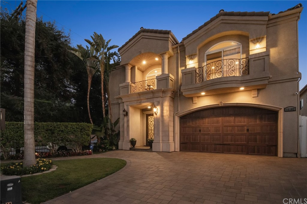 Front of the home at twilight.