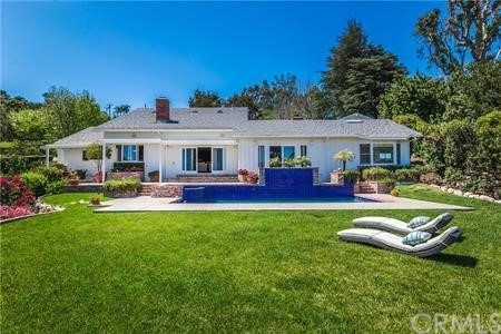Lovely, elegant entry way. Large grassy area with mature trees.