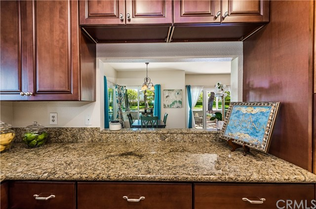 You won't miss any of the conversations in the dining area while preparing meals in the kitchen.