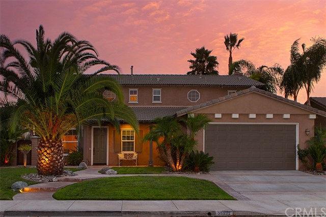 Set within the award winning Temecula Valley School District, this tropical retreat awaits. From the moment you arrive, you will appreciate all the efforts to make this house an oasis. The professional landscaping carries the tropical theme throughout the property. Awaiting you, in the backyard, is a heated salt water pool & spa for your leisure time. The attention to detail remains consistent when you enter the door & move through this space. A large, modern kitchen with granite countertops & ample storage is a place where memories can be made with family gathered at the large kitchen island. Open to the family room, a centralized fireplace creates a cozy setting and is ready to ward off any chill when the weather calls for it. All bedrooms have ceiling fans & most have walk-in closets. One bedroom is downstairs; the master & remaining 3 bedrooms reside upstairs. Your new master is a spacious haven with dual under mount sinks, granite counters, and separate shower & soaking tub in the bath. The huge, walk-in closet adds a finishing touch to a space awaiting your arrival. Smart touches include heat-reflective shades & a remote controlled, retractable backyard awning to cool and increase energy efficiency. There is an ADT alarm system in place and the ease of remote controls for the pool & spa. If that weren't enough, there are multiple parks within walking distance from its cul-de-sac locale. Low HOA fees of $14/month & a Tax Rate of 1.049% should help with your decision.