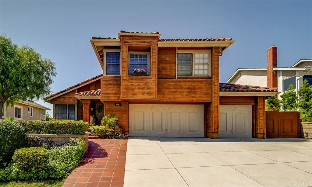 """Major Price Reduction!!  Fix and save!  Incredible opportunity to own this ocean view 4 bed, 2.5 bath home located in the """"The Coast"""" neighborhood.  This Tradewinds model boasts over 2,500 SF of living space on two levels with an attached 3-car garage.  Entertain in the spacious living room complete with skylights and a vaulted ceiling that continues into the formal dining room.  Prepare meals in the sunny eat-in kitchen complete with double ovens and a garden window.  The kitchen opens to the fireside family room with access to the patio.  Recharge in the inviting master suite featuring a spacious retreat with a brick fireplace, vaulted ceiling, walk-in closet, soaking tub and double vanity.  Step outside onto the large patio perfect for outdoor entertaining or relax and enjoy the private backyard.  Conveniently located close to beaches, Shorecliffs Golf Course and Highway 5.  Surrounded by shopping and dining!"""