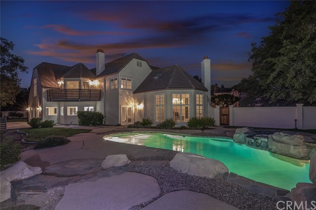 Check out this one-of-a-kind stunning gated home with beautiful panoramic views of the Santiago Canyon Park. With over $100,000 invested, this 2.5-acre estate boasts 5 bedrooms and 4 1/2 bathrooms. The ground floor includes a spacious bedroom with a walk-in closet and an en-suite bathroom. Step into your luxurious open concept kitchen/living area with brand new top-of-the-line LG appliances, new Calacatta Leon countertops, white shaker cabinets, and Adessi Sundance tile flooring. Upstairs you will find the dreamy master bedroom, perfectly situated to enjoy views from your balcony deck, featuring a fireplace and an ensuite bathroom with a contemporary freestanding tub, glass shower, sauna, and a dream come true walk-in closet.  Enjoy beautiful sunsets on your new entertainer's dream deck and then cool off in your re-plastered pool and jacuzzi. This home isn't going to last — come quick before it's gone!