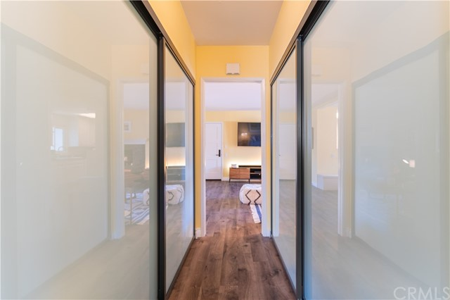 Hallway, with storage on both side.
