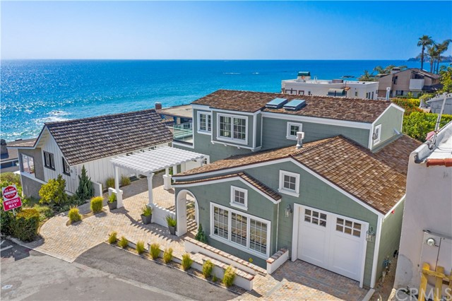 "Luxury Live Auction! Bidding to start from $4,000,000! Two remodeled coastal contemporary historic homes resting on one iconic ocean view lot near the sand. This property is documented as Laguna's first home built in 1883 and was the residence of Laguna's noted architect Thomas Harper in the 1920s-40s. Highlighting white-water views from every window, the elegantly transformed main home is 3 bedrooms, 3 baths plus a loft and maintains elements of the original structure. Original cottage windows and flooring in the modern kitchen and hallway heightens the charm and magic. Listen to the sound of the surf from every location on the property. Additionally, this coastal compound includes a 1,600 sq. ft. guest home with 3BD/3BA, a rare 3 car attached garage, and 2 additional parking spaces. Designed in a modern coastal flair this tranquil space boasts a large family room, open kitchen area, and upstairs master with view balcony. Ideal for additional family members or as a rental income property. Take advantage of low property tax credits through the ""Mills Act."" The new owner(s) of this magnificent, unique gem will enjoy beach activities, close proximity to the many fantastic Laguna eateries, and all the luxurious lifestyle amenities along the California Riviera."