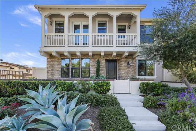 Welcome to 1861 Harvest Circle. This stunning former model home constructed in 2016 has 4 bedroom and 3 full bathrooms. This is the largest model built with the largest driveway within the community, & tons of natural sunlight throughout the home. The main level features an open floor plan with all the modern upgrades such as recessed lighting, and rustic porcelain flooring throughout. The living and dinning room windows have remote controlled window shades. Flowing into the kitchen is a large quartz counter island, white subway tile backsplash, modern industrial pendant lights, and large sliding door to access the side yard. There is a bedroom and full bathroom on the main floor that is currently being used as an office. Upstairs, you're in for a treat. The master bedroom features a wood beamed ceiling, and double French doors gives you access to your private balcony with views of the park. The master bathroom features and industrial modern barn door, double sinks, separate shower and bathtub, and a large walk-in closet. Outside the master bedroom is the loft that can used as a media play space or a study area. There is also an upstairs laundry room. The second floor features 2 additional large bedrooms and full bathroom. The 2 car garage is fully finished with epoxy flooring and built-in storage, it also comes equipped with a 240v outlet for your electric vehicle. Paid off Solar, and low HOA. Close to 5,55,261 frwy, The Market Place, Trader Joe's, Costco, Tustin Ranch Golf.