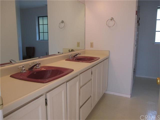 Master Bath has dual sinks, shower and a commode.