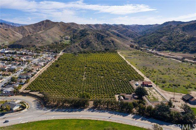 77 acres with 20 level acres of lemons and a 3bd 2ba ranch style home. Convenient access from Hwy 33 on the way to Ojai, North of the Ventura City limits~'Path of Progress' area. Zoned AE (Agriculture Exclusive) yet bordersa residential subdivision to the north and the historic 6500 acre Cañada Larga Ranch to the east.