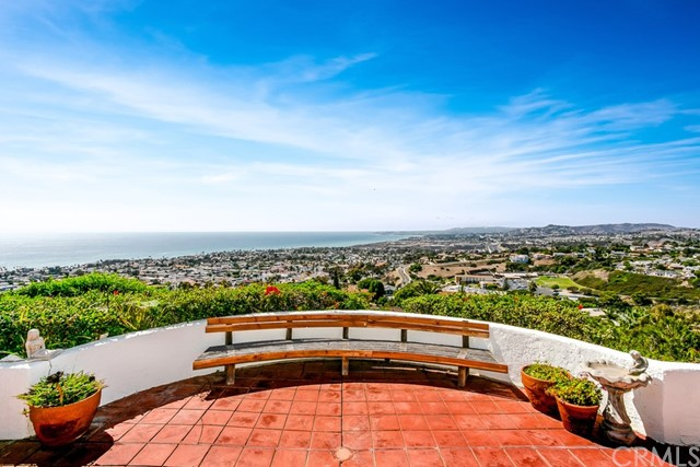 Spectacular panoramic ocean and coastline views from the moment you open the front door! Spanish Villa home features a gated courtyard entrance, 3 bedrooms plus an office, cathedral vaulted ceilings with an open floor plan, breathtaking ocean views from nearly every room. Main floor master suite includes a huge walk-in closet, dual vanities and a large step in shower. Two bedrooms upstairs are on separate sides- each with its own spacious viewing deck. Great location on a quiet single loaded street at the top of the hill. Enjoy outdoor living and beautiful sunsets every night.