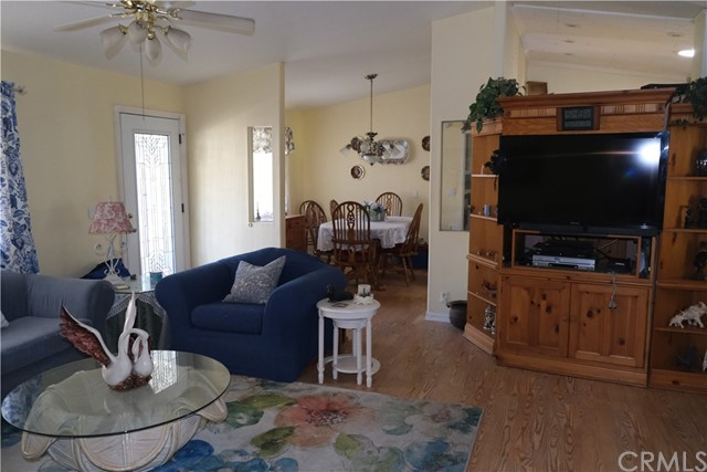 Vaulted Ceilings throughout give a SPACIOUS Feel. Dining room and Combination Living and Family Room just off the Glass Paneled Entry Door.  Entertainment center for your TV and storage.