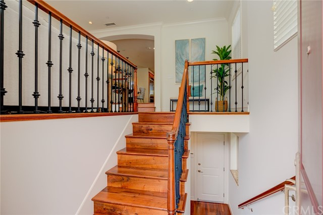 Entry leads up a short flight to living areas, down to 4th bed/bath and garage access