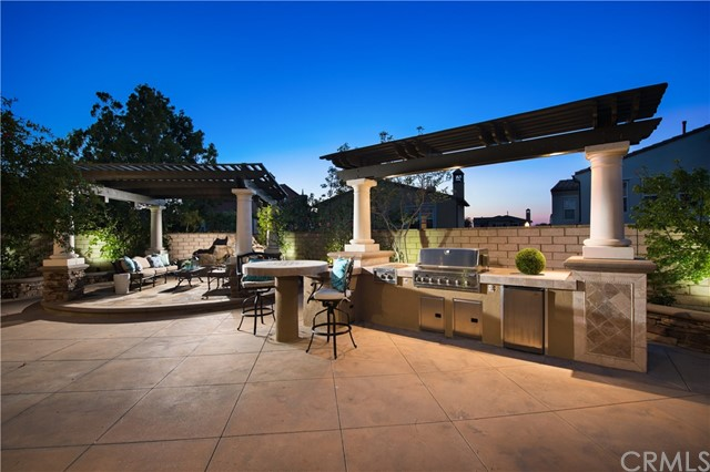 STUNNING Sienna Quail Hill estate home situated high above city with view on premium cul-de-sac lot! Largest Plan 4 offered by Standard Pacific in this coveted upscale community. This residence combines the best of privacy & luxury living. The 4080SF of interior living space encompasses a formal living & dining room, Chef's dream kitchen w/ generous-sized island, stainless steel appliances & 6 burner range stove. Downstairs private indoor courtyard w/ beautiful custom flooring, fireplace, & large interior glass windows for a cozy retreat. Downstairs offers 1 full bedrooms & 1 full bath with a separate executive office with built in custom cabinets, 2 car garage. Upstairs loft area with bar and beautiful french doors leading to over-sized balcony with views of city lights and Irvine Spectrum. Extravagant master bedroom w/ separate retreat currently used as a private gym. Spa-inspired master bath w/ his-and- hers organized closets. 2 generous-sized secondary bedrooms w/ large closets & private balcony. Entertainer's dream over-sized backyard offers the perfect venue for any occasion. Built in BBQ, full bar with stools, pizza oven, and shaded seating area with tranquil waterfall fountain. This premier property is offered in Irvine's idyllic Quail Hill community w/ 5 parks, 3 Olympic-sized pools, Community Summer Swim Team, Upscale Fitness Center. Close to nature trails & beach. Located in award-winning University High School region of the Irvine Unified School District.