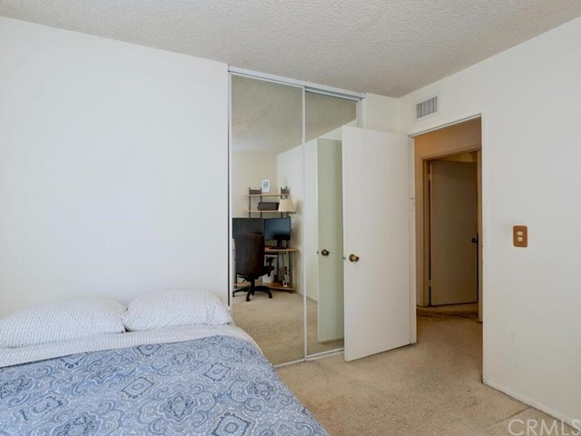 Secondary bedroom includes mirrored wardrobe.