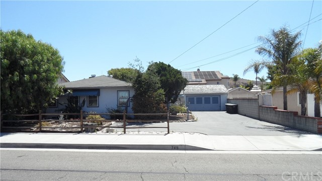 3BR 2BA 1896 sq. ft. single story home on spacious flat lot with long driveway leading to two car garage.  Separate Accessory Dwelling Unit (ADU) 520 sq. ft. has been added behind the garage.  This single story, ground level (for grandma) ADU Studio apartment is not permitted and features 1 BA, mini-split A/C & heating unit, closet, and kitchen area with sink & formica counter tops, but no cooking facilities.  Front house features family room with brick fireplace and beautiful original wood paneling, living room with fireplace, and dining room with built-in hutch. Most front house rooms have ceiling fans.  Master bathroom has beautifully maintained original black & white tile counters & walls with separate shower & tub.  Dual closets with built-ins.  Kitchen features original blue formica countertops with aluminum edging!  So retro!  Also, gas stove & micro hood.  Laundry hookups are in separate room off kitchen, washer & dryer are included.  There is also a covered patio on the North side of the home with two ceiling fans to enjoy those HOT summer evenings!  Front house features central heat & air conditioning.  The rear lawn is artificial turf so you don't have to spend your weekends mowing! Block walls on all sides of the property.