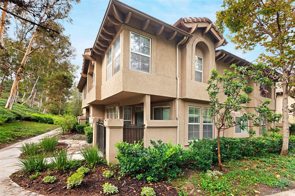 93 Waxwing is a rare, private, Aliso Viejo end unit with a patio and a garage.