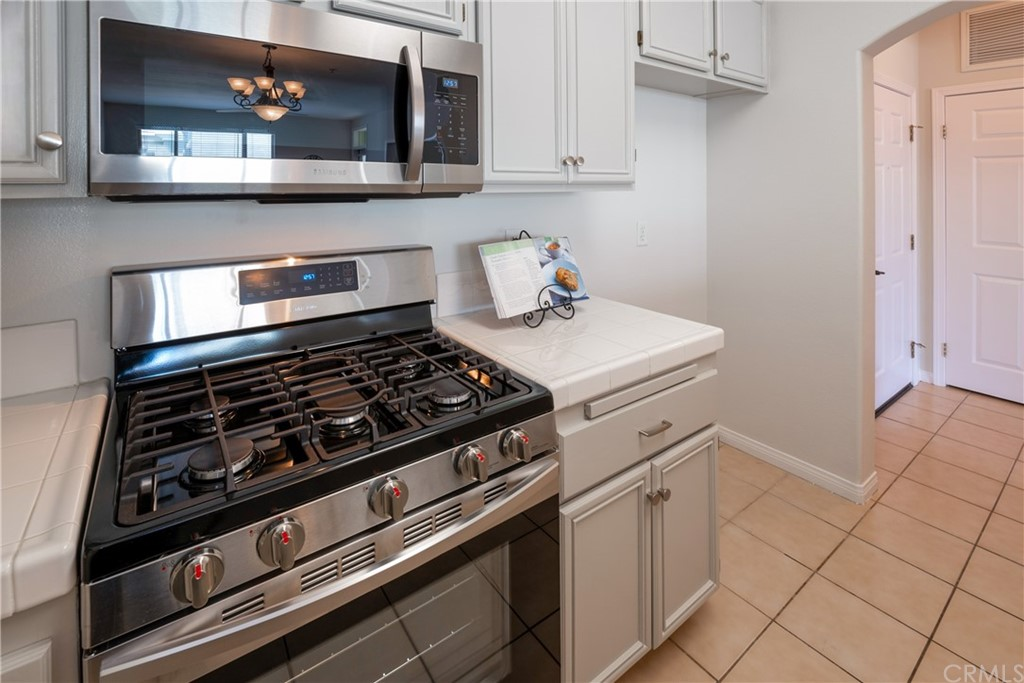Brand New Stainless Steel Appliances Includes Refrigerator (Installed Before COE), Range/Oven, Microwave/Fan and  Dishwasher)